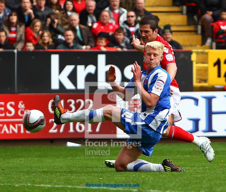 Picture by John Rainford/Focus Images Ltd. 07506 538356.05/05/12.Yann Kermorgant of Charlton Athletic and Darren Holden of Hartlepool United during the Npower League 1 match at The Valley stadium, London.