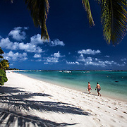 Tourists on the beach at Le Morne Brabant, Mauritius. Le Morne Beach is on a peninsula in the southwest and it boasts some of the quietist and most beautiful beaches and resorts in the country.