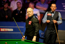 John Higgins (left) and Mark Williams on day seventeen of the 2018 Betfred World Championship at The Crucible, Sheffield.