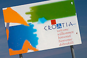 a sign saying Croatia Welcome with a picture of a person on a beach Orebic town, holiday resort on the south coast of the Peljesac peninsula. Orebic town. Peljesac peninsula. Dalmatian Coast, Croatia, Europe.