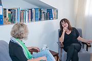 A female therapist during a one on one session with a client seeking help in her consulting room