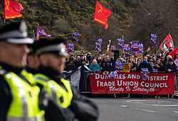 Edinburgh, Scotland, UK. 23 March, 2019. March to the Scottish Parliament in Edinburgh by far-right Scottish Defence League (SDL) was met by a counter demonstration by several left wing groups such as Unite Against Fascism, Muslin Women's Association and Edinburgh Antifa. A heavy police presence was in force and the SDL were closely escorted to and from Waverley Station. Pictured; counter demonstration by anti rascist protestors