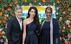 George Clooney and his wife Amal, representing the Clooney Foundation for Justice, arrive to collect an award for their charity work at the People's Postcode Lottery Charity Gala in Edinburgh <br /> <br /> Pictured: George Clooney and wife Amal Clooney <br /> <br /> (c) Aimee Todd | Edinburgh Elite media