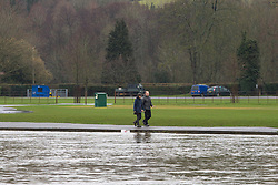 Walkers on the towpath, just inches above the rising waters of the River Thames at Henley, Oxfordshire, as heavy rains in the River Thames catchment area and saturated ground causes the river to rise to within inches of bursting its banks. April 02 2018.