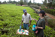 Faith D'Aluisio, co-author of the book, What I Eat: Around the World in 80 Diets, arranges the food items of Kibet Serem, a tea producer and small scale farmer in Kericho, Kenya. (From the book What I Eat: Around the World in 80 Diets). Kibet cares for this small tea plantation near Kericho, Kenya, that his father planted on their property when Kibet was a young boy. He is responsible for milking the cows that his family owns. He sells extra milk to a nearby school for a government feeding program and gives some to his mother who makes yogurt and sells it. His staple food is ugali, a maize meal porridge.
