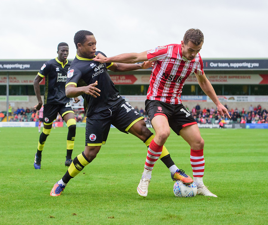 Lincoln City's Harry Toffolo shields the ball from Crawley Town's Ashley Nathaniel-George<br /> <br /> Photographer Chris Vaughan/CameraSport<br /> <br /> The EFL Sky Bet League Two - Lincoln City v Crawley Town - Saturday September 8th 2018 - Sincil Bank - Lincoln<br /> <br /> World Copyright © 2018 CameraSport. All rights reserved. 43 Linden Ave. Countesthorpe. Leicester. England. LE8 5PG - Tel: +44 (0) 116 277 4147 - admin@camerasport.com - www.camerasport.com