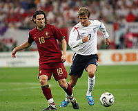 Photo: Chris Ratcliffe.<br /> England v Portugal. Quarter Finals, FIFA World Cup 2006. 01/07/2006.<br /> David Beckham of England clashes with Maniche of Portugal.