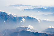 High peaks and ridges of the Peruvian Andes in mist, as viewed from an airplane on September 25, 2005.