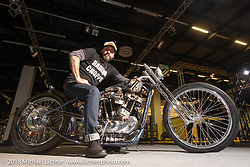 """Andrea Radaelli of Radikal Choppers Italy on """"The Skinny"""" Harley-Davidson 1,000cc Ironhead XLCH he built for 70's Helmets owner Fabrizio Caoduro in the AMD World Championship of Custom Bike Building in the Intermot Customized hall during the Intermot International Motorcycle Fair. Cologne, Germany. Sunday October 7, 2018. Photography ©2018 Michael Lichter."""