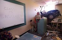 California Highway Patrol officer Kelly Baraga (CQ) investigates the crash of a Mazda RX7 that flew through air off westbound I-80, cleared a fence and flew 15 feet into the computer classroom filled with students at Heald College located in Roseville CA., Thursday May 9, 2002. The driver and several people inside the class room were transported to the hostpital.