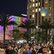 People watch as a floating lantern floats into the sky during a vigil at the Dr. Phillips Center for the Performing Arts for the victims of a mass shooting at the Pulse nightclub Monday, June 13, 2016, in Orlando, Florida.  A gunman killed dozens of people in a massacre at the crowded gay nightclub in Orlando on Sunday, making it the deadliest mass shooting in modern U.S. history. (Alex Menendez via AP)