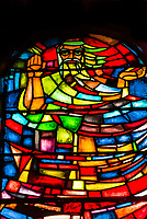 Beautiful stained glass windows with characters from the Bible; Debre Libanos Monastery, Oromia Region, Ethiopia.