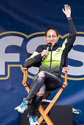 Des Linden waves to fans at FanFest in Copley Square<br /> Boston Marathon weekend