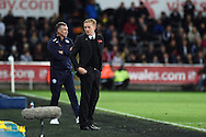 Swansea city manager Garry Monk ® and Leicester city manager Nigel Pearson look on. Barclays Premier league match, Swansea city v Leicester city at the Liberty stadium in Swansea, South Wales on Saturday 25th October 2014<br /> pic by Andrew Orchard, Andrew Orchard sports photography.