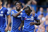 Victor Moses of Chelsea ® celebrating after scoring his sides 3rd goal to make it 3-0 with Michy Batshuayi of Chelsea. Premier league match, Chelsea v Burnley at Stamford Bridge in London on Saturday 27th August 2016.<br /> pic by John Patrick Fletcher, Andrew Orchard sports photography.