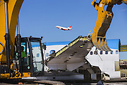 A DC-9 used for battling wildfires takes off during the demolition of the 757 on Wednesday. Boeing's facility is on the east side of the Grant County International Airport in Moses Lake. <br /> <br /> Mike Siegel/The Seattle Times