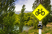 Road sign on the Alps to Ocean Cycle Trail at Lake Aviemore, Canterbury, South Island, New Zealand