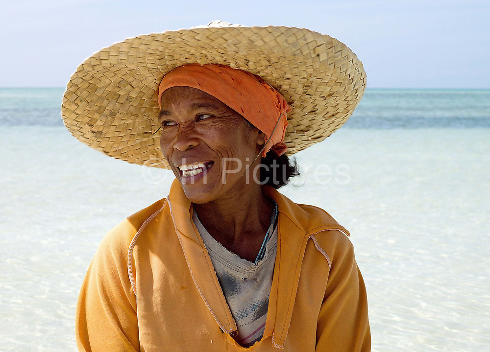 Marie Clar Labtik (50), Shell Collector in Pooc, Bantayan Island, The Philippines. The shells are used to make necklaces and other products for tourists.
