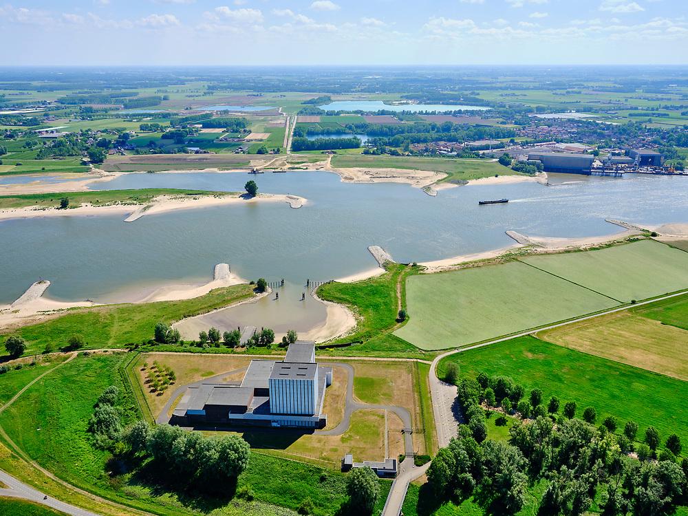 Nederland, Gelderland, Gemeente Neder-Betuwe, 14–05-2020; Dodewaard, Waalbandijk met Kernenergiecentrale te Dodewaard (KCD) of Kerncentrale GKN. De voormalige Kerncentrale is buiten bedrijf gesteld en de zgn. 'Veilige insluiting' is gerealiseerd. Na een wachttijd van veertig jaar zal de centrale in 2045 ontmanteld worden. Rivier de Waal zorgde in het verleden voor koelwater.<br /> Former Nuclear Power Plant, has been taken out of operation and the so-called 'Safe Inclusion' has been realized. Dismantling will take place in the year 2045 after a waiting period of forty years.<br /> luchtfoto (toeslag op standaard tarieven);<br /> aerial photo (additional fee required)<br /> copyright © 2020 foto/photo Siebe Swart