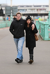 © Licensed to London News Pictures. 26/10/2014. Brighton, UK. A couple taking a relaxing walk on Brighton Promenade. A cloudy day with possibility of some localised showers. The temperatures are expected to reach 15C in Brighton and the South Coast. Photo credit : Hugo Michiels/LNP