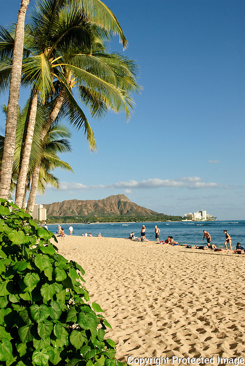 The sands of Waikiki Beach with Diamond Head in the background.
