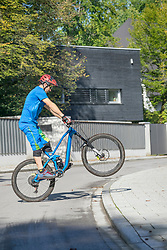 Man doing a wheelie with mountain bike, Bavaria, Germany