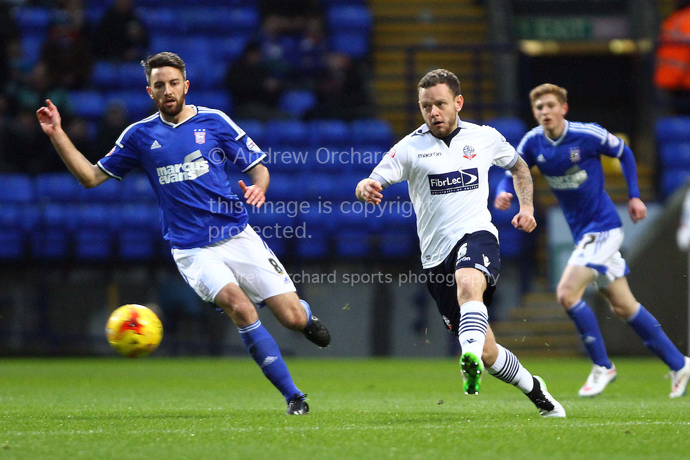 Jay Spearing of Bolton Wanderers (r) passes the ball. Skybet football league championship match, Bolton Wanderers v Ipswich Town at the Macron stadium in Bolton, Lancs on Saturday 13th December 2014.<br /> pic by Chris Stading, Andrew Orchard sports photography.