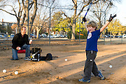Carson Cason, 6, celebrates after hitting a ball over the fence with his father Chris Cason as they practice baseball in the warm weather at Burleson Park near SMU on Wednesday, January 20, 2013 in Dallas, Tx. Carson said his favorite player used to be Josh Hamilton but not anymore. (Cooper Neill/The Dallas Morning News)