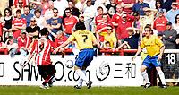 Photo: Alan Crowhurst.<br />Brentford v Nottingham Forest. Coca Cola League 1. 14/04/2007. Brentford's Thomas Pinault (L) opens the scoring 1-0.
