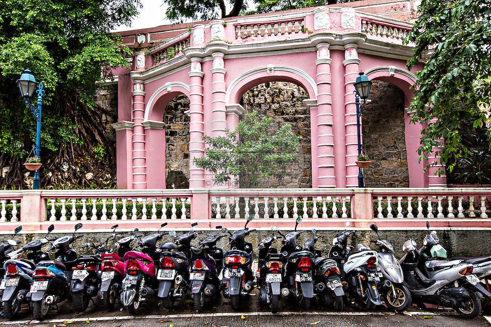 Scooters parked along the Jardim do Sao Francisco or Sao Francisco Garden in Macau.