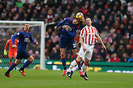 Marouane Fellaini of Man Utd (l)  jumps for a header with  Charlie Adam of Stoke city.Premier league match, Stoke City v Manchester Utd at the Bet365 Stadium in Stoke on Trent, Staffs on Saturday 21st January 2017.<br /> pic by Andrew Orchard, Andrew Orchard sports photography.