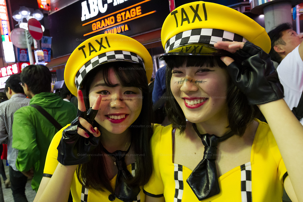 Two woman dressed as taaxi drivers during the Halloween celebrations Shibuya, Tokyo, Japan. Saturday October 27th 2018. The celebrations marking this event have grown in popularity in Japan recently. Enjoyed mostly by young adults who like to dress up, drink , dance and misbehave in parts of Tokyo like Shibuya and Roppongi. There has been a push back from Japanese society and the police to try to limit the bad behaviour.