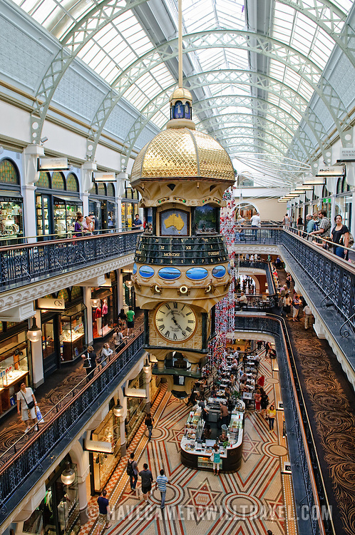 Interior of the lavish Queen Victoria Building shopping mall on George Street in Sydney's CBD. The large suspended clocks in the middle are ornately decorated and involve complicated and novel ways of indicating the time.