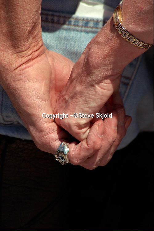 Hands clasped together at Memorial Day service.  St Paul Minnesota USA