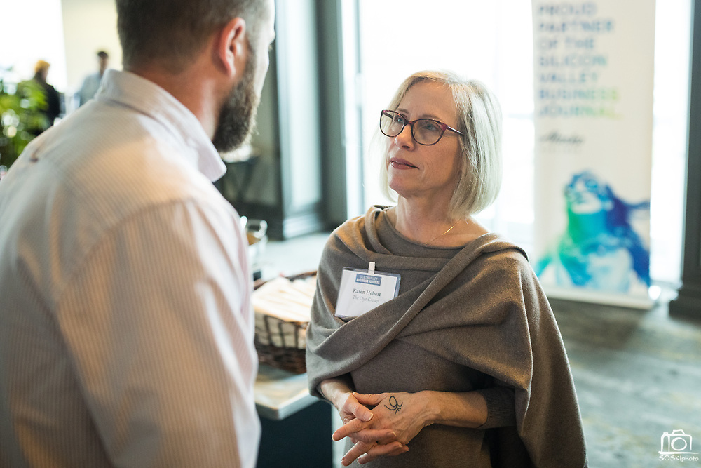 Kevin Haller (left) and Karen Hebert (right) socialize during the Business of Cannabis event at the Silicon Valley Capital Club in San Jose, California, on April 4, 2019. (Stan Olszewski for Silicon Valley Business Journal)