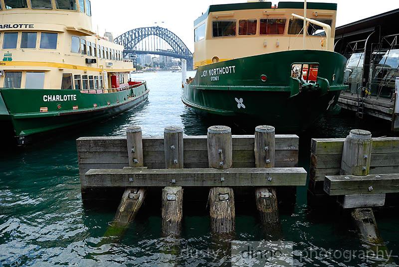 Sydney Harbour ferries at mooring, Sydney Harbour Bridge in background. Circular Quay, Sydney, Australia