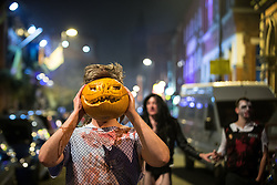 © Licensed to London News Pictures . 01/11/2015 . Manchester , UK . Pumpkin face . Halloween revellers , wearing make up and costumes , out and about in Manchester City Centre . Photo credit : Joel Goodman/LNP