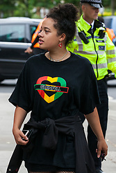 London, UK. 14th June, 2018. People arrive for the Grenfell Memorial Service at St Helen's Church.
