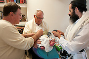 Circumcision - Brith Mila Ceremony The mohel at work