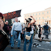 People dancing in front of the Greek parliament during the the protests in Athens against the  unpopular austerity measures, June 29, 2011