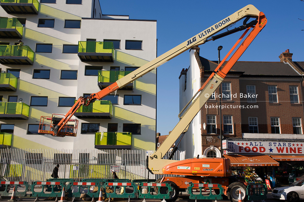 New apartments and crane in a block developed by Skanska in Coldharbour Lane in Camberwell, Lambeth, South London