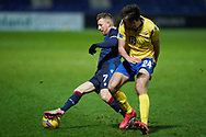 Michael Gardyne of Ross County and Callum Booth of St Johnstone during the Scottish Premiership match between Ross County FC and St Johnstone FC at the Global Energy Stadium, Dingwall, Scotland on 2 January 2021during the Scottish Premiership match between Ross County FC and St Johnstone FC at the Global Energy Stadium, Dingwall, Scotland on 2 January 2021