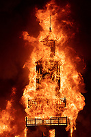 The Folly Burn<br /> by: Dave Keane & The Folly Builders<br /> from: San Francisco, CA<br /> year: 2019<br /> <br /> The Folly represents an imaginary shantytown of funky climbable towers and old western storefronts, cobbled together from salvaged and reclaimed lumber from original San Francisco Victorians to be reborn in the desert, affording shelter, entertainment and perspective to the community.<br /> <br /> URL: www.thefollybrc.com<br /> Contact: info@thefollybrc.com<br /> <br /> https://burningman.org/event/brc/2019-art-installations/?yyyy=&artType=H#a2I0V000001AVkAUAW