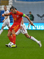 Football - 2020 / 2021 UEFA Nations League - Group B4 - Wales vs Bulgaria<br />      <br /> Gareth Bale of Wales defends <br /> in a match played with no crowd due to Covid 19 coronavirus emergency regulations, in an almost empty ground, at the Cardiff City Stadium.<br /> <br /> COLORSPORT/WINSTON BYNORTH