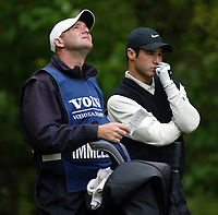 Photograph: Scott Heavey<br />Volvo PGA Championship At Wentworth Club. 23/05/2003.<br />Trevor Immelman chooses which club to use on the 5th.