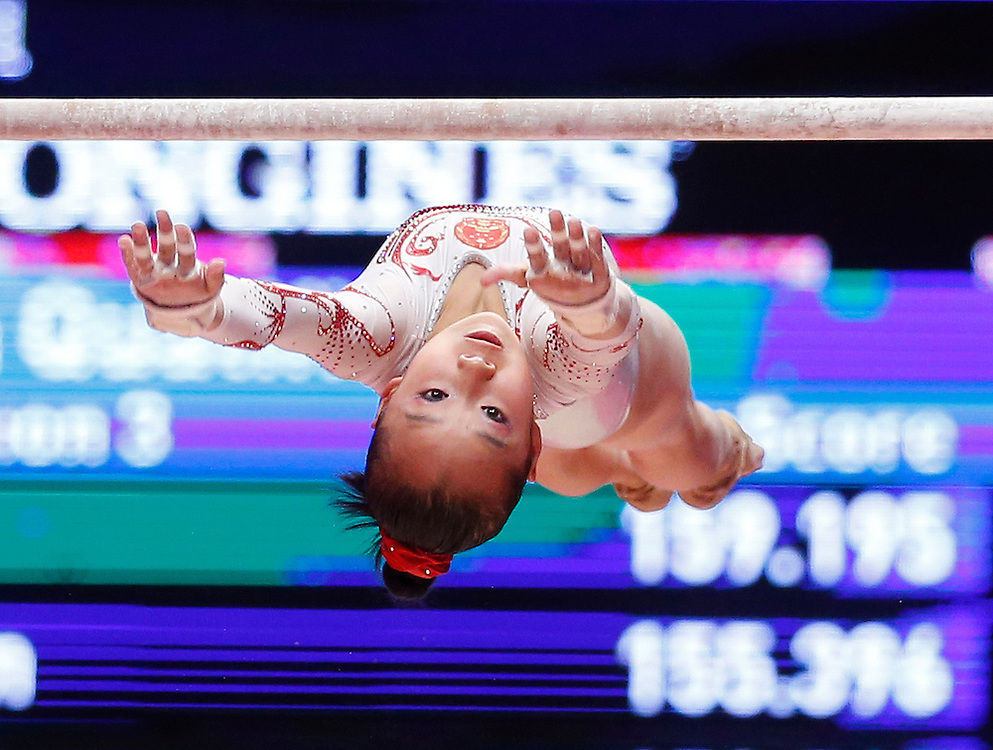 Yilin Fan of China performs on the Uneven Bars of China at the 46th FIG Artistic Gymnastics World Championships in Glasgow, Britain, 24 October 2015.