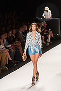 Muted blue chambray shorts and a shawl collar floral print shirt tied at the waist.