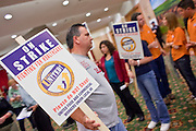 Nov. 11, 2009 -- PHOENIX, AZ: MANUEL ARVALLO, an employee of Frys' accepts a picket sign during a meeting of members of the UFCW at the Airport Marriott Hotel in Phoenix. The United Food and Commercial Workers Union (UFCW) Local 99 has about 25,000 members in Arizona: 15,000 in Fry's grocery stores and Fry's Marketplace, 9,500 in Safeway stores and 400 in Smith's grocery stores. The union voted down the last proposal from the stores and has announced plans to go on strike at 6PM on Friday, Nov. 13. The meeting Wednesday is the last one before the strike.   Photo by Jack Kurtz