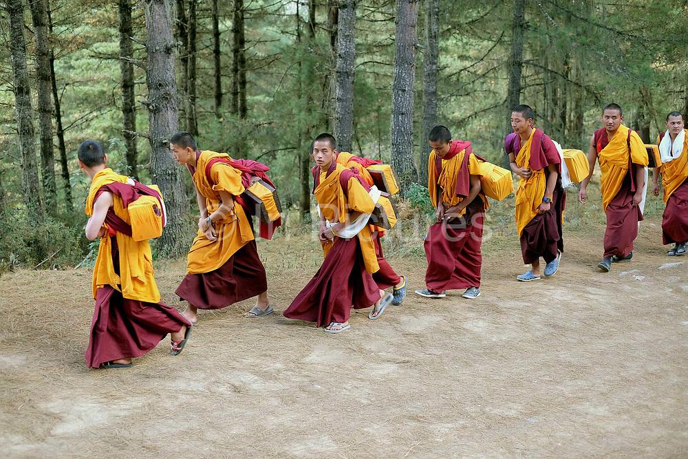 Monks walking on the road towards Gangte Goemba in Phobjikha valley, Bhutan.