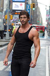 very sexy muscular man standing in Times Square in New York City